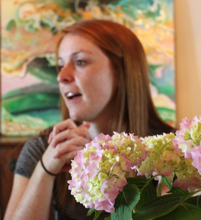 Food, family and flowers: our older daughter Cassie with hydrangeas we took to my apartment-dwelling dad to grace the luncheon table.