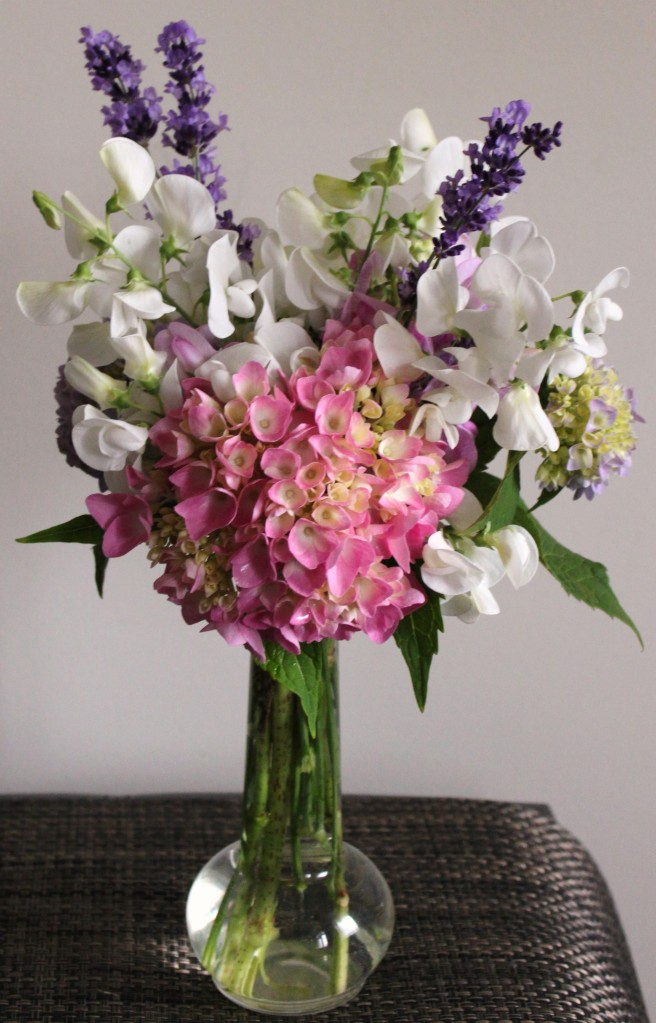 Petite and perfect round arrangement echoed by the vase's round base
